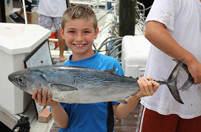 boy holding large fish